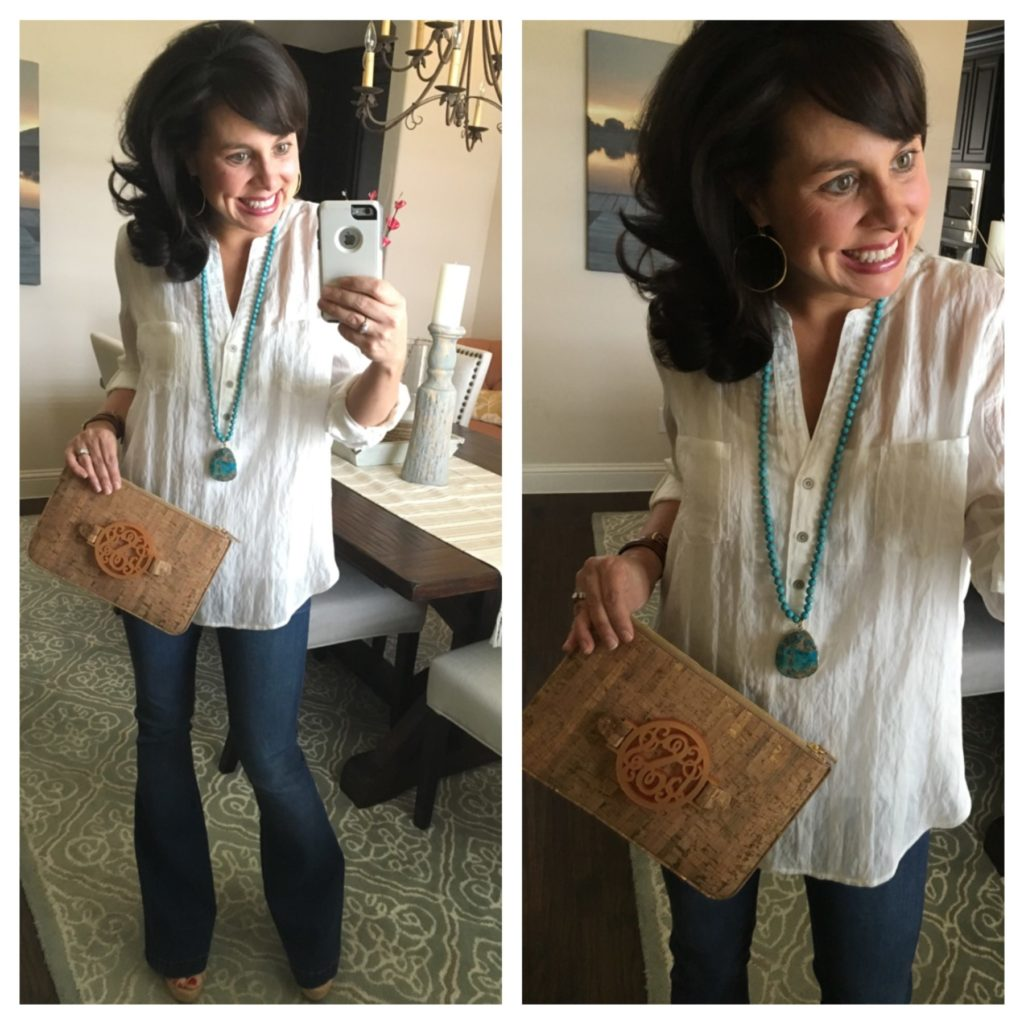 white shirt, flares, and cork clutch