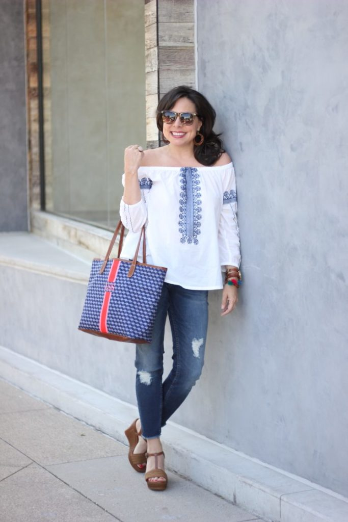 blue and white embroidered top