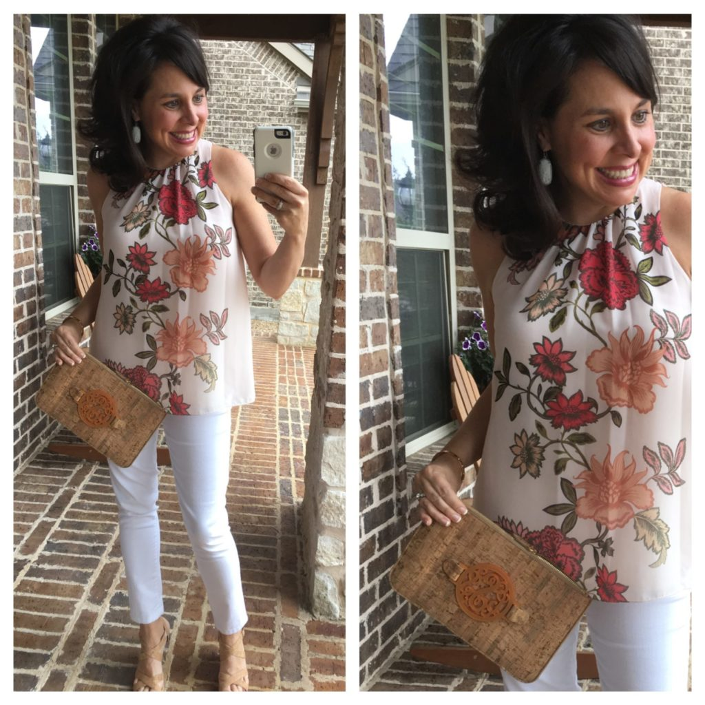 floral top and white jeans with cork clutch