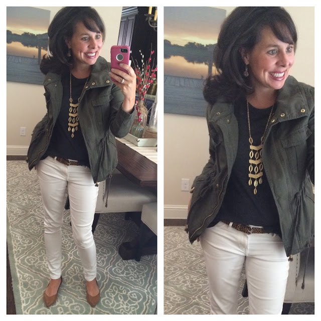military jacket and white jeans