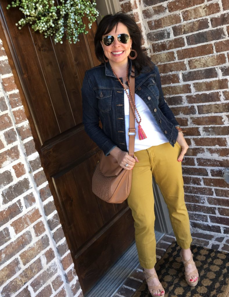 mustard pants, denim jacket, white tee, cork wedges, and tassel necklace