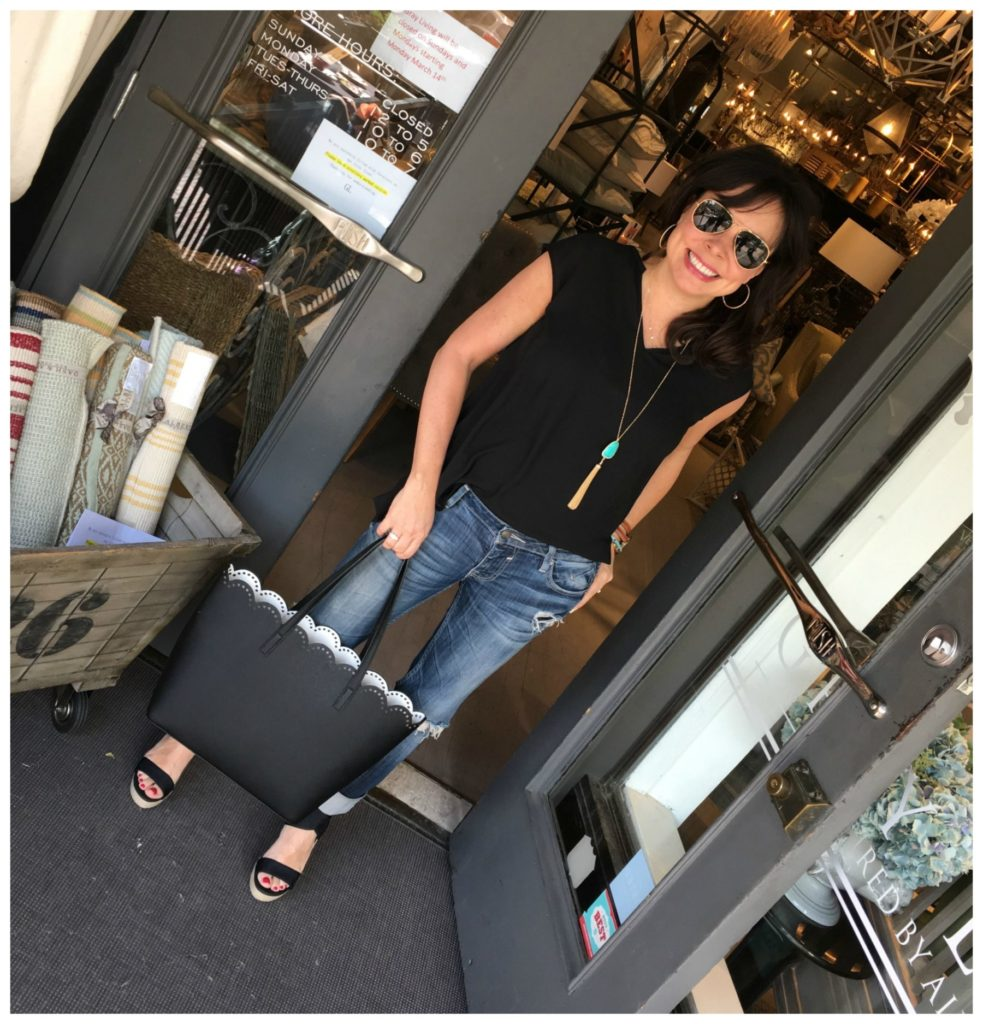 scallop tote, black blouse, and jeans