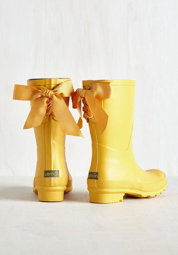 yellow rain boots with bows